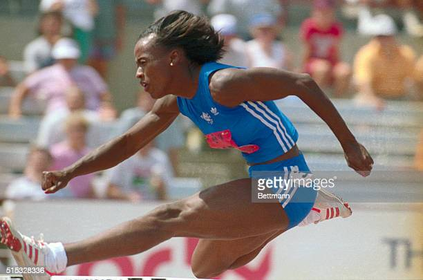 Jackie Joyner-Kersee of long Beach California, clears a hurdle July 15 on the way to an American record in the heptathlon 100 meter hurdles, during...