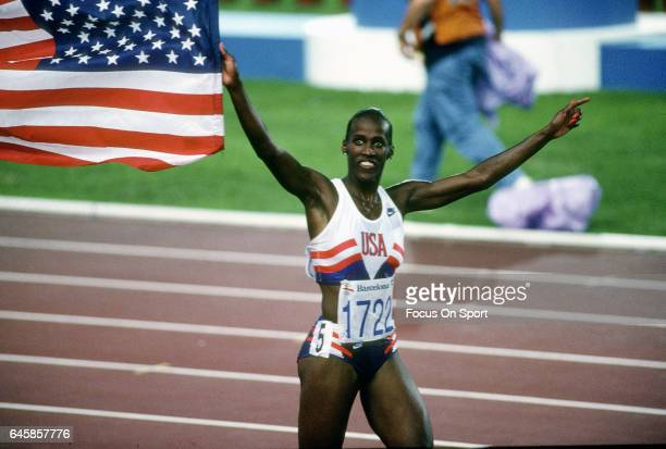 Jackie Joyner-Kersee of the United States celebrates carrying the American Flag during the heptathlon competition in the Games of the XXV Olympiad in...