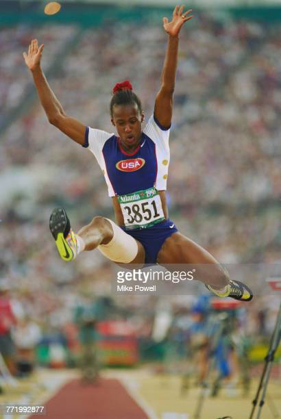 Jackie Joyner-Kersee of the United States competes in the Women's Long Jump with a strapped leg due to a hamstring injury at the XXVI Olympic Summer...