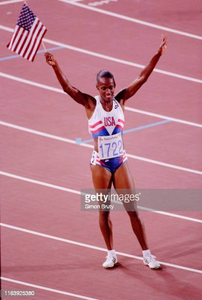 Jackie JoynerKersee of the United States waves the stars and stripes flag after winning the Women's Heptathlon competition on 2nd August 1992 during...