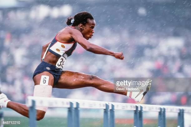 Jackie Joyner-Kersee of the USA runs the 100 meter hurdle race of the Heptathlon event of 1996 Summer Olympics on July 27, 1996 in the Centennial...
