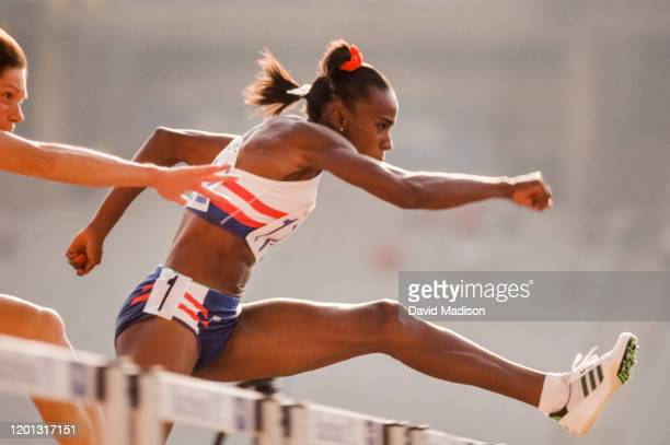 Jackie Joyner-Kersee runs the 100 meter hurdles during the Heptathlon event of the Athletics competition of the 1992 Olympics on August 1, 1992 at...