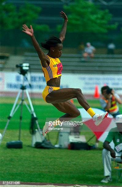 Jackie JoynerKersee sails through the air on her second attempt in the heptathlon long jump 7/16 JoynerKersee is on a record pace in the heptathlon...