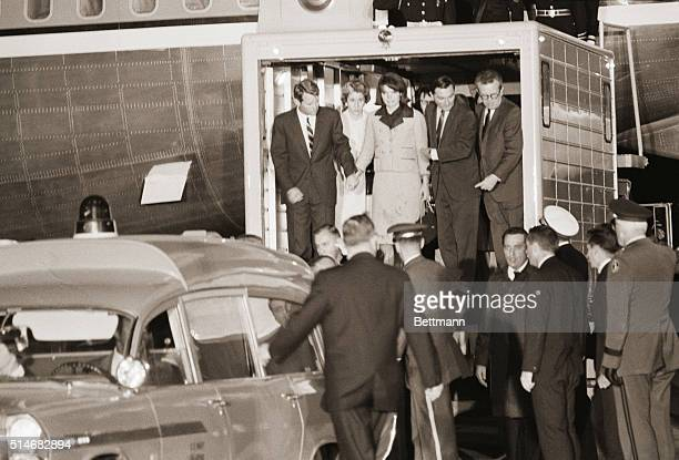 Jackie Kennedy and Attorney general Robert Kennedy watch the casket of the late John F Kennedy is lowered from the plane on November 22 at Andrews...