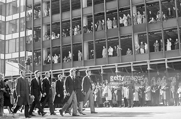 Jackie Kennedy leads the funeral procession of her late husband John F Kennedy Walking with her are her brothersinlaw Robert and Ted Kennedy as well...