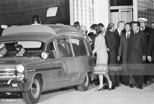 Jackie Kennedy stands behind the ambulance containing her husband's corpse on November 22 1963 President Kennedy was assassinated only hours earlier...