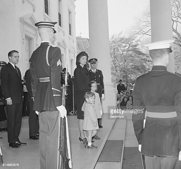 Jackie Kennedy stands with her children Caroline and John Jr at the start of the funereal procession for her late husband President Kennedy was...