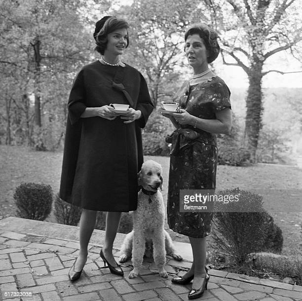 Jackie Kennedy stands with her mother Janet Lee Auchincloss and a French poodle Kennedy is the wife of presidential hopeful Senator Kennedy and is at...