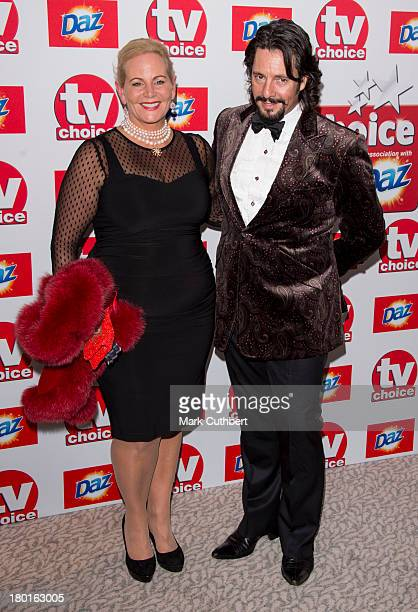 Jackie LlewelynBowen and Laurence LlewelynBowen attend the TV Choice Awards 2013 at The Dorchester on September 9 2013 in London England