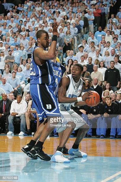 Jackie Manuel of the North Carolina Tar Heels moves the ball against Shelden Williams of the Duke Blue Devils during the game on March 6 2005 at the...