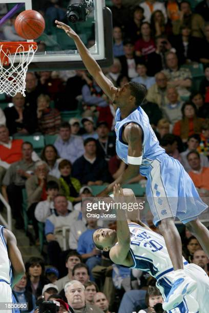 Jackie Manuel of the University of North Carolina Tar Heels is fouled by Dahntay Jones of the Duke Blue Devils during their semifinal game of the ACC...