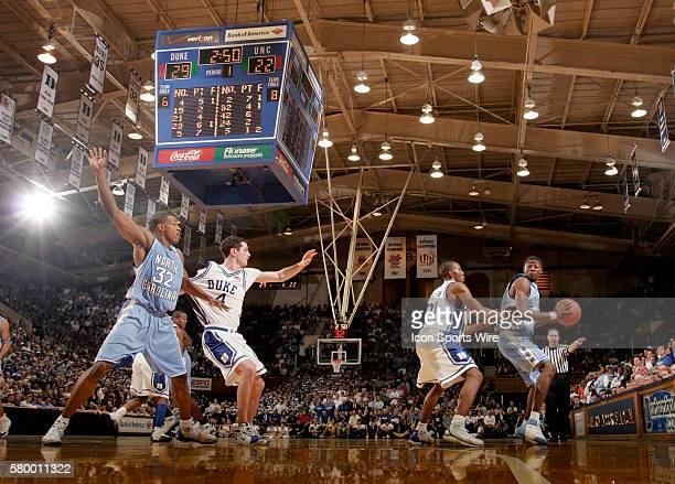 Jackie Manuel right of North Carolina is guarded by DeMarcus Nelson 21 of Duke as JJ Redick 4 of Duke tries to hold off Rashad McCants 32 of North...