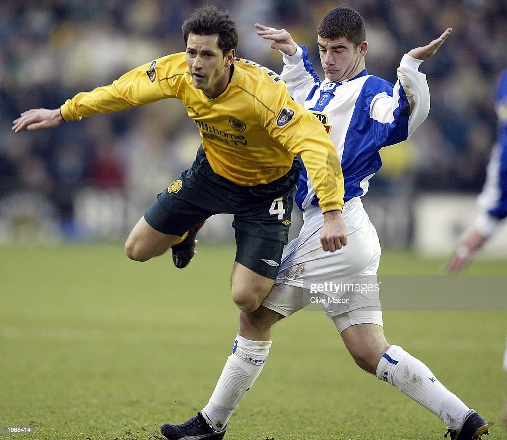 Jackie McNamara of Celtic is brought down by Alistair Mitchell of Kilmarnock : News Photo