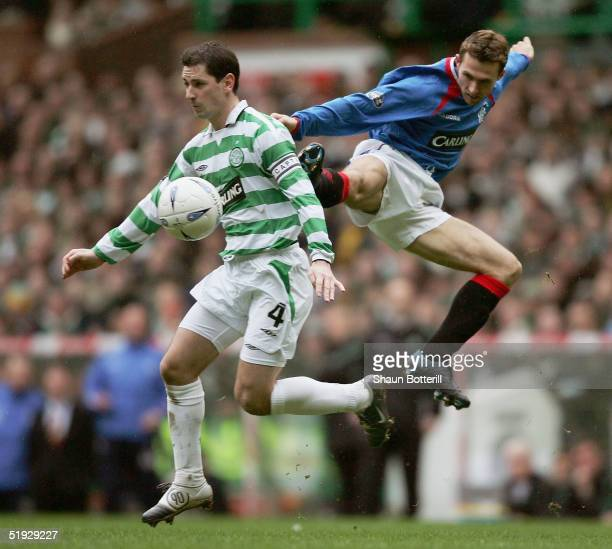 Jackie McNamara of Celtic is challenged by Thomas Buffel of Rangers during the Tennants Scottish Cup 3rd round match between Celtic and Rangers at...