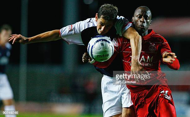 Jackie McNamara of Falkirk tackles Sone Aluko of Aberdeen during the Clydesdale Bank Scottish Premier league match between Falkirk and Aberdeen at...