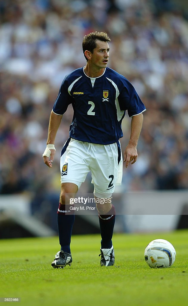 Jackie McNamara of Scotland brings the ball forward during the European Championships 2004 Group 5 Qualifying match between Scotland and the Faroe Islands held on September 6, 2003 at Hampden Park, in Glasgow, Scotland. Scotland won the match 3-1.
