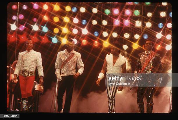 Jackie Michael Marlon and Tito Jackson perform together on stage