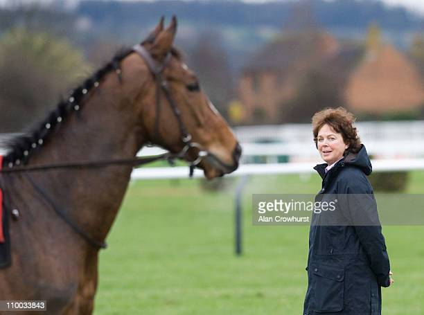Jackie Mullins wife of trainer Willie watches over the horses during exercise prior to the festival meeting commencing on Tuesday at Cheltenham...