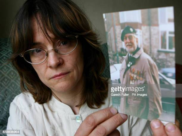 Jackie Nixon holds a picture of her father Joe Nixon who died on August 8 after he contracted chlostridium difficile in Maidstone Hospital Kent