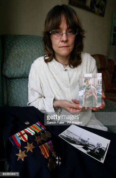 Jackie Nixon with pictures of her father Joe Nixon and his medals who died on August 8 after he contracted chlostridium difficile in Maidstone...