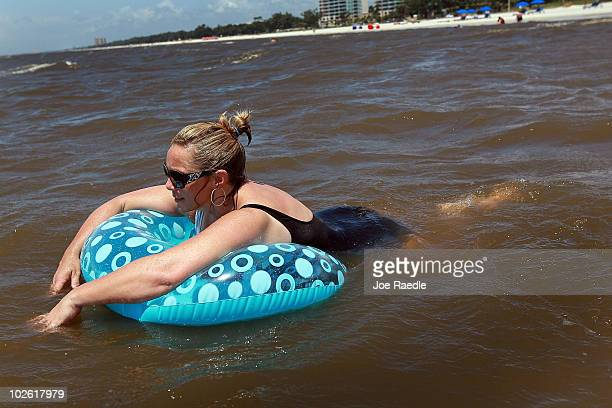 Jackie Norwood on vacation from Oklahoma enjoys the beach despite the threat of contamination from the Deepwater Horizon oil spill in the Gulf of...