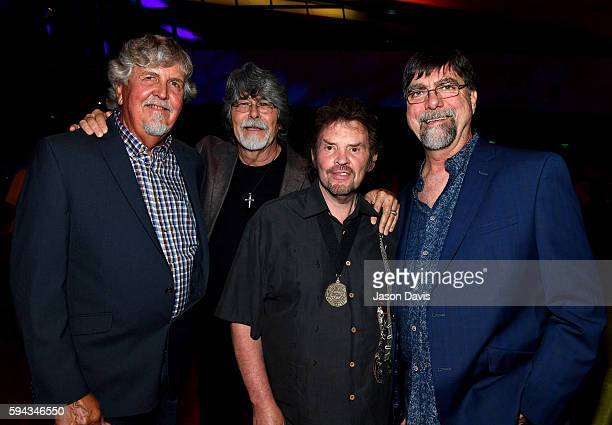 Jackie Owen poses with Randy Owen Jeff Cook and Teddy Gentry of the band Alabama attend the debut of the 'Alabama Song of the South' exhibition at...