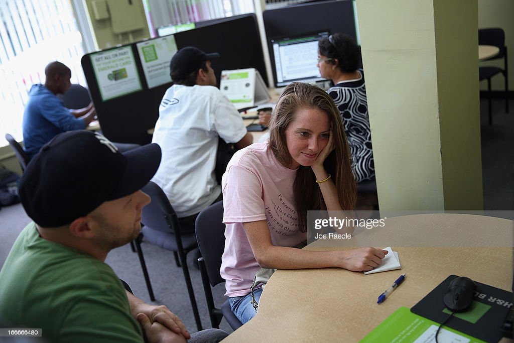 Jackie Parsons (R) waits for a tax associate, as she prepares to do her taxes at the H&R Block office on April 15, 2013 in Miami Beach, Florida. With the U.S. tax deadline of midnight April 15 rapidly approaching, last-minute filers are rushing to get their returns done.