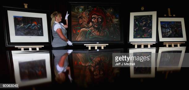 Jackie Pearson an assistant at McTears holds Hope by artist Peter Howson on October 20 2009 in Glasgow Scotland More than 200 works by renowned...