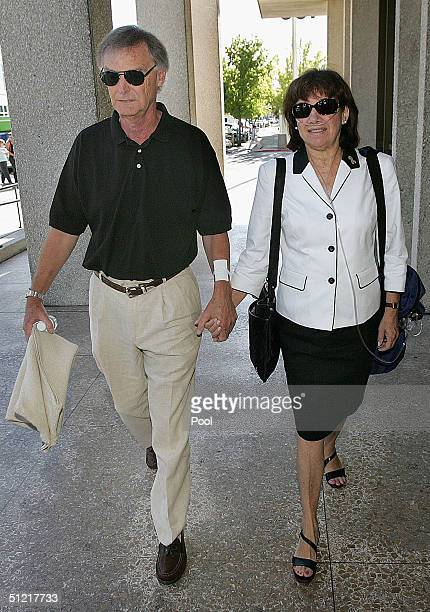 Jackie Peterson the mother of Scott Peterson along with Scott's father Lee Peterson walk to the lobby of the San Mateo Superior County Court House...