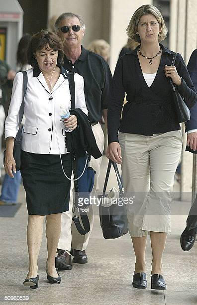 Jackie Peterson with Lee Peterson parents of Scott Peterson and Susan Caudillo sister of Scott Peterson walk outside the San Mateo County Courthouse...
