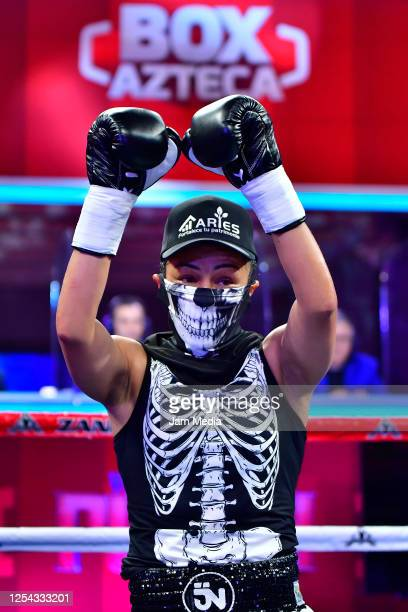 Jackie 'Princesa' Nava celebrates defeating Estrella 'Chacala' Valverde during an unofficial fight at TV Azteca as part of Volvemos con Punch TV show...