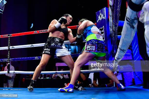 Jackie 'Princesa' Nava punches Estrella 'Chacala' Valverde during an unofficial fight at TV Azteca as part of Volvemos con Punch TV show on July 4...
