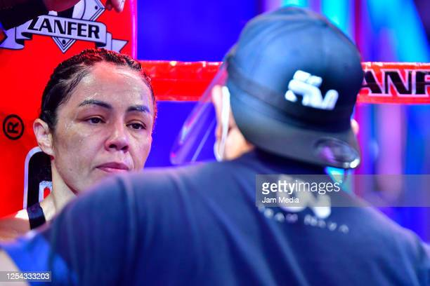 Jackie 'Princesa' Nava receives instructions in her corner during an unofficial fight at TV Azteca as part of Volvemos con Punch TV show on July 4...