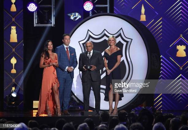 Jackie Redmond Elliotte Friedman Willie O'Ree and Kathryn Tappen present the Willie O'Ree Community Hero Award during the 2019 NHL Awards at the...