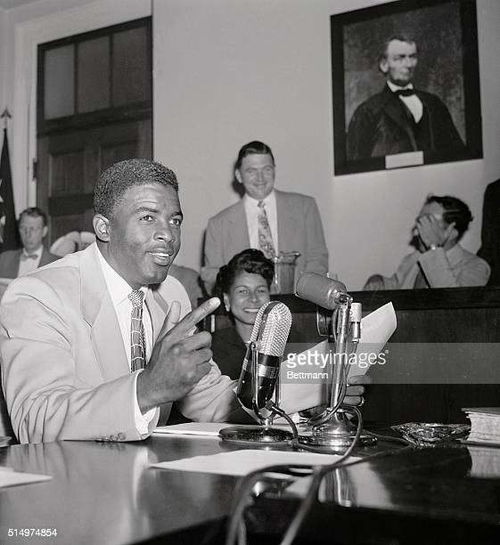Jackie Robinson, ace second baseman for the Brooklyn Dodgers, told the House Unamerican Activities Committee today that singer Paul Robeson was...