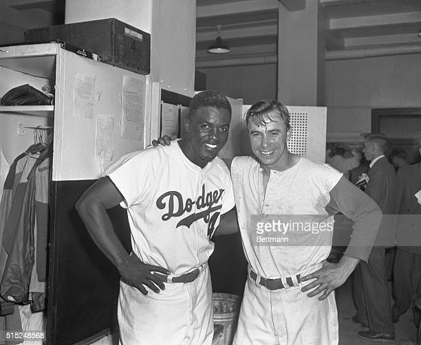 Jackie Robinson and Pee Wee Reese stand in the locker room after Game 1 of the 1952 World Series. Both hit home runs, helping the Dodgers take home a...