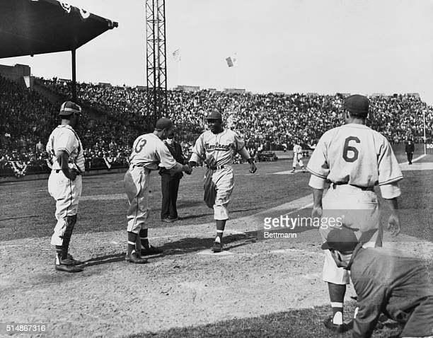 Jackie Robinson crosses homeplate after hitting a three-run home run, on Opening Day of the 1946 Montreal Royals season. Today Robinson becomes the...