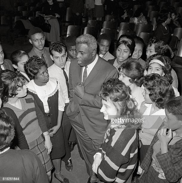 Jackie Robinson exDodger star talking with school children at Joan of Arc Junior High School in New York City