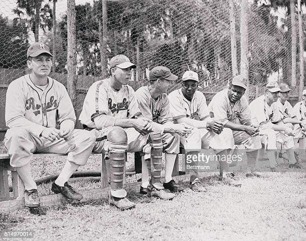Jackie Robinson first Negro player to be signed by a major league ball club and Johnny Wright another Negro player are pictured with other members of...