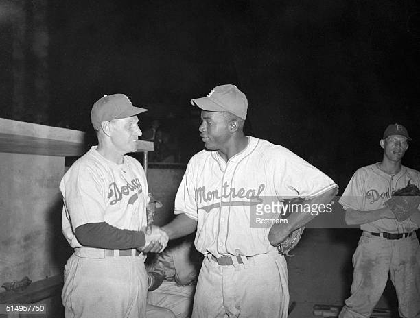 Jackie Robinson Negro infielder with the Montreal Royals farm team of the Brooklyn Dodgers is greeted by Leo Durocher the Dodger's manager at the...