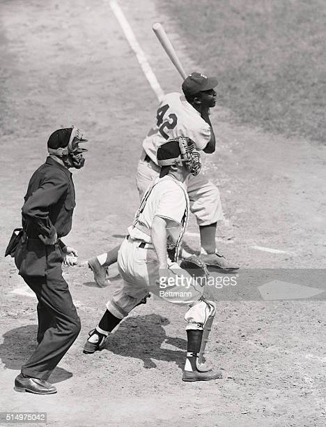 Jackie Robinson of the Brooklyn Dodgers is shown getting his 101st hit of the season in the third inning of the game against the New York Giants at...