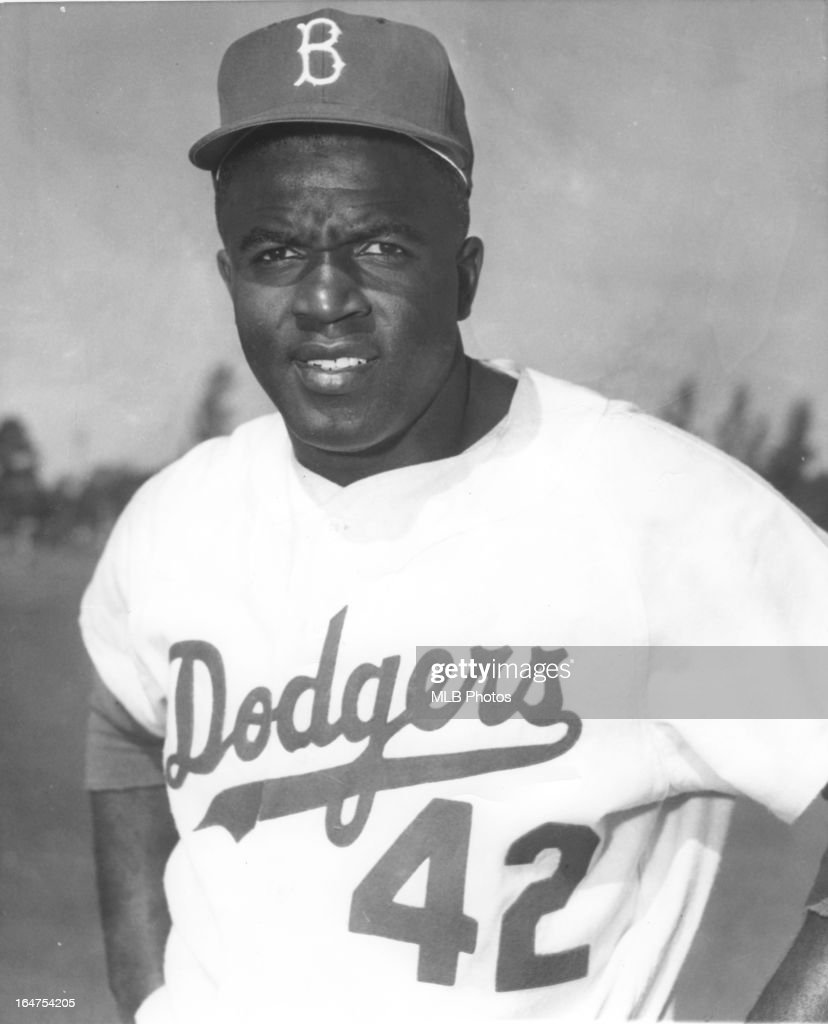 Jackie Robinson #42 of the Brooklyn Dodgers poses for a portrait in an undated and unspecified location.
