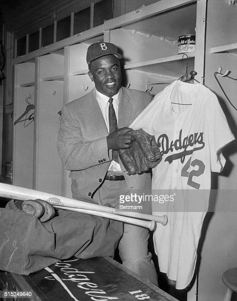 Jackie Robinson packing his baseball gear in the Dodger locker room at Ebbets Field.