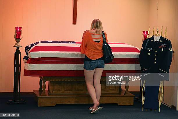 Jackie Rozek spends a quiet moment with the remains of her longtime boyfriend US Army Pfc Aaron Toppen in a chapel at Vandenberg Funeral Home on June...