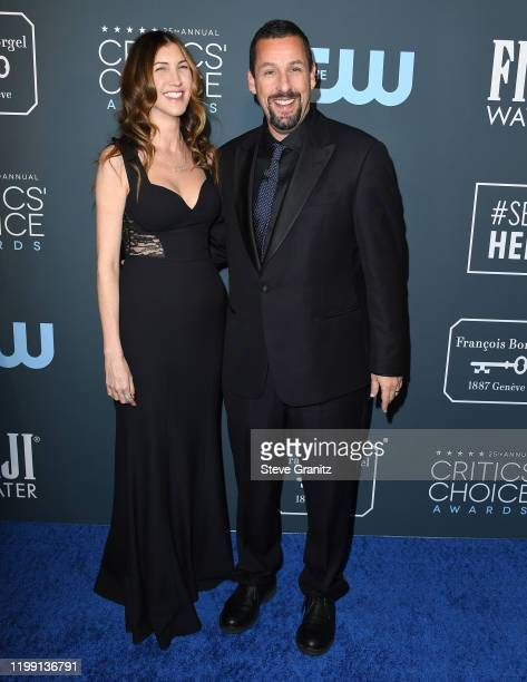 Jackie Sandler and Adam Sandler arrives at the 25th Annual Critics' Choice Awards at Barker Hangar on January 12 2020 in Santa Monica California