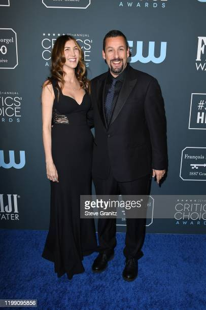 Jackie Sandler and Adam Sandler attend the 25th Annual Critics' Choice Awards at Barker Hangar on January 12 2020 in Santa Monica California