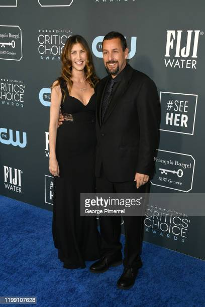Jackie Sandler and Adam Sandler attend the 25th Annual Critics' Choice Awards held at Barker Hangar on January 12 2020 in Santa Monica California