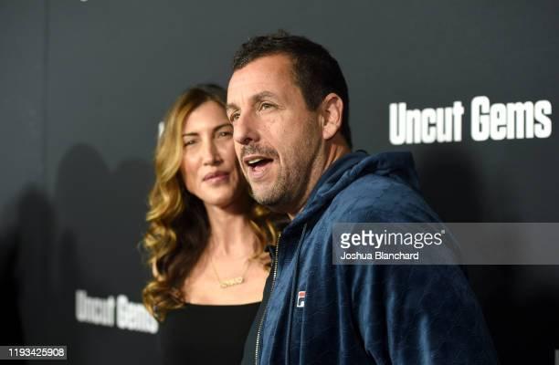 Jackie Sandler and Adam Sandler attend the Los Angeles premiere of Uncut Gems on December 11 2019 in Los Angeles California
