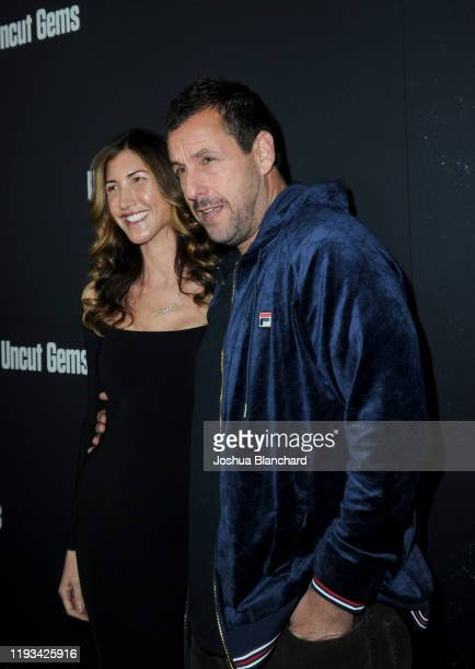 Jackie Sandler and Adam Sandler attend the Los Angeles premiere of Uncut Gems on December 11 2019 in Los Angeles California