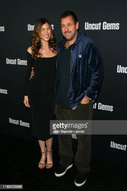 Jackie Sandler and Adam Sandler attend the premiere of A24's Uncut Gems at The Dome at Arclight Hollywood on December 11 2019 in Hollywood California